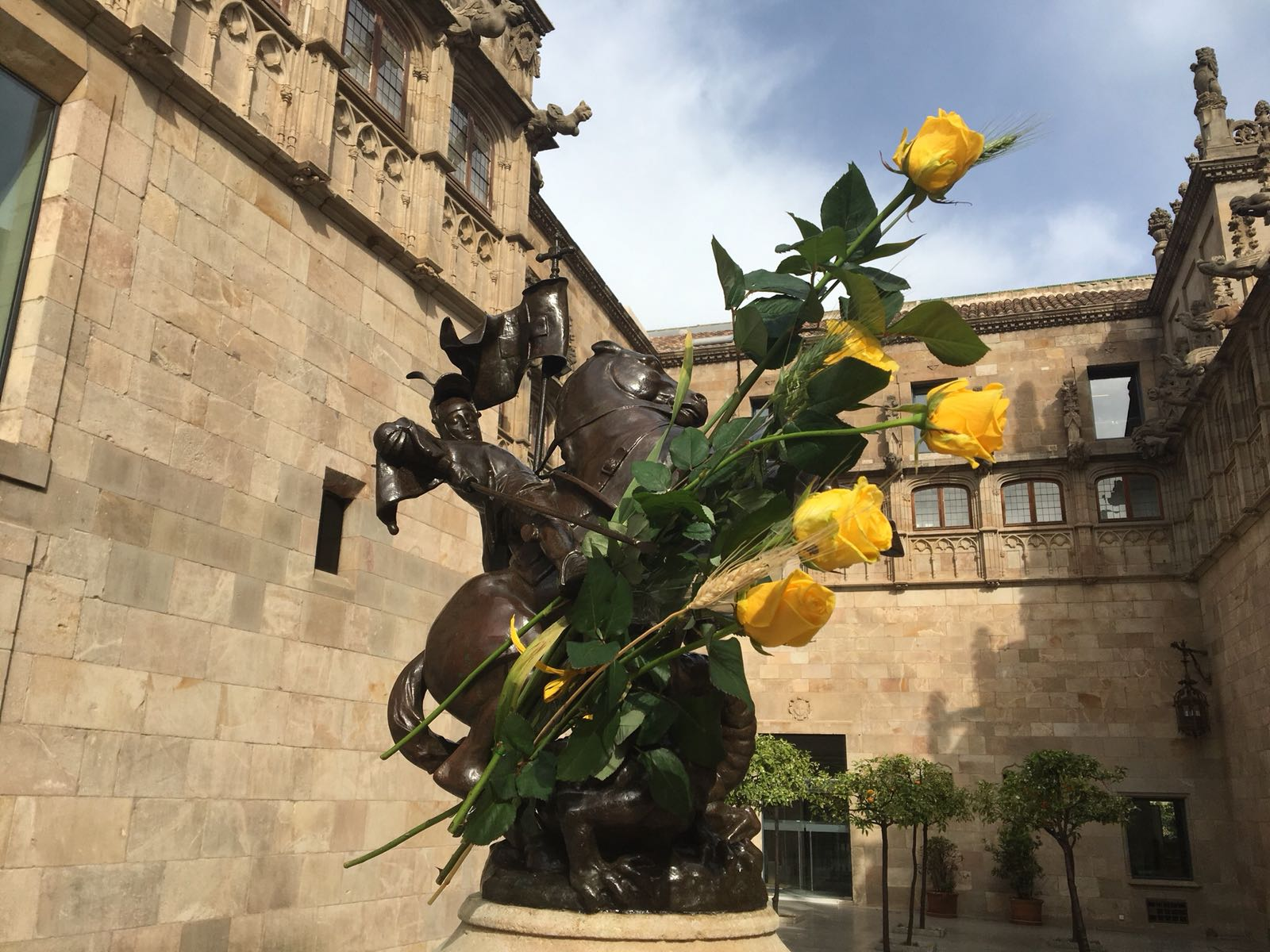 Catalan government palace surrounded by yellow roses