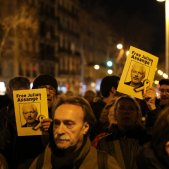 Catalan pro-independence groups march in support of Julian Assange