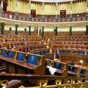 An almost-empty parliament extends Spain's state of alarm in late-night vote