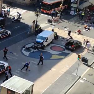 At least thirteen dead after van hits pedestrians on Barcelona's Rambla
