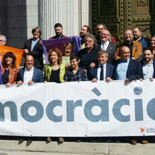 "Catalan parties protest outside Spanish Congress with ""Democracy!"" banner"