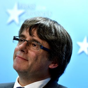 Puigdemont challenges Rajoy to respect election result, discounts escaping justice
