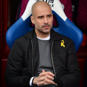 FA charges Pep Guardiola for wearing a yellow ribbon loop