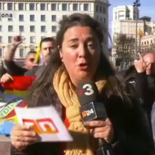 Police officers at protest interrupt Catalan newscaster