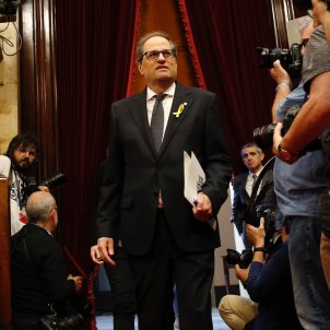 Torra's new Catalan government restores jailed and exiled ministers to posts