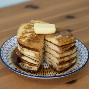A stack of fluffy breakfast pancakes
