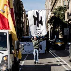 Extremists in Barcelona flaunt Nazi symbol banned in Germany