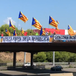 Catalan motorway bridges turn red, yellow and blue in independence protest