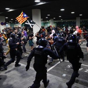 Videos: Police use force against protesters at Barcelona-El Prat airport