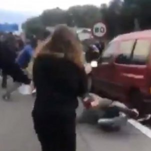 VIDEO: Catalan protesters hit by accelerating car as highway blockages continue