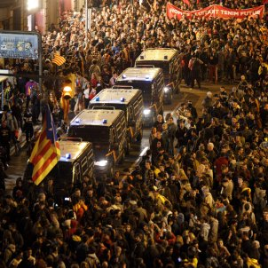 Riot squads act against protesters outside Spanish police station in Barcelona