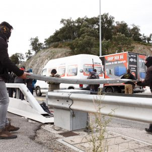 Videos: Catalan protesters block main road across French border