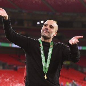 Pep Guardiola rient EFE