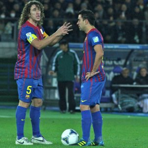 Puyol Xavi Messi Barça / Wikimedia Commons / Christopher Johnson