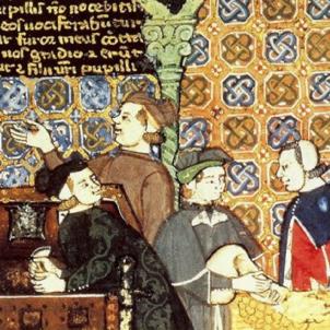 Entra en funcionament la Taula de Canvi de Barcelona. Representació medieval d'un grup de negociants. Font Enciclopedia Britànica
